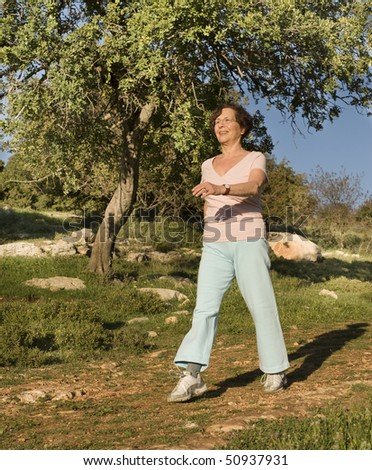 senior women walking on a path - stock photo