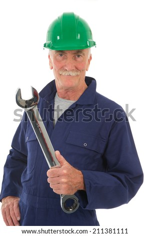 senior worker in blue overall with wrench isolated over white background - stock photo