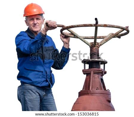 Senior workman turning huge valve gate at factory isolated on white background - stock photo