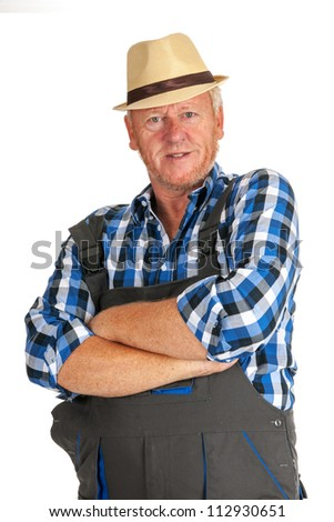 senior workman with working wear and straw hat - stock photo