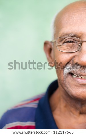 Seniors and feelings, elderly black man with glasses and mustache smiling. Cropped view, copy space - stock photo