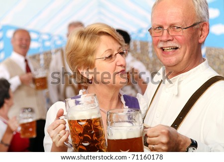 seniors at a bavarian beer tent - stock photo