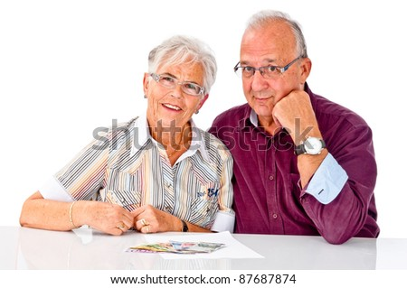 Seniors couple is happy about a lot of money - stock photo
