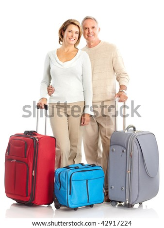 seniors couple with bags. Isolated over white background - stock photo