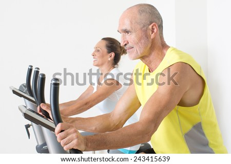 Seniors doing spinning - stock photo