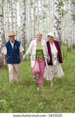 seniors - father, daughter and mother - happy family - stock photo