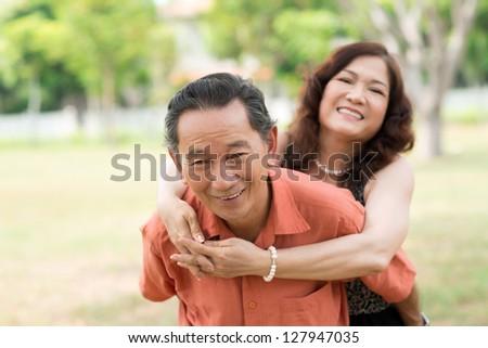 Seniors having fun outdoors recalling their youth - stock photo