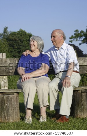 Seniors on a park bench. - stock photo