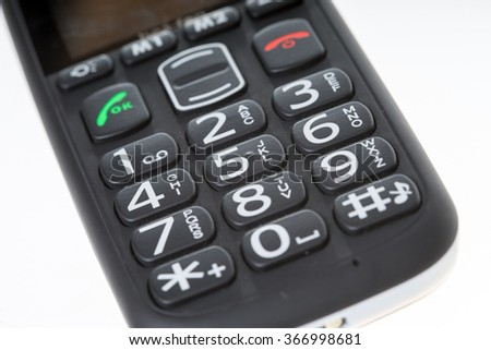 Seniors phone with big buttons on a bright background / Seniors phone - stock photo