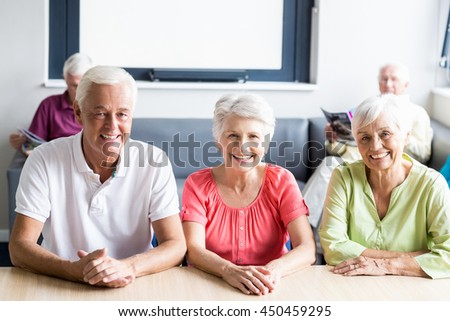 Seniors sitting at a table in a retirement home