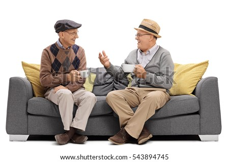 Seniors sitting on a sofa and talking isolated on white background