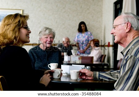 Seniors socializing - stock photo
