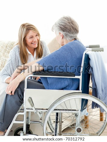Seniors talking together in the living room - stock photo