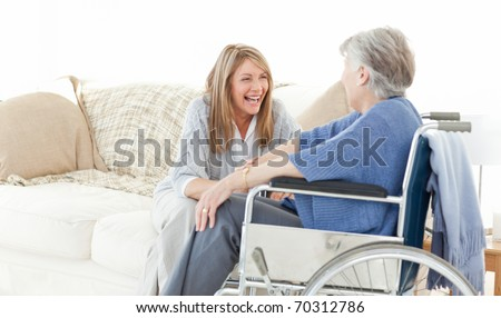 Seniors talking together in the livingroom - stock photo