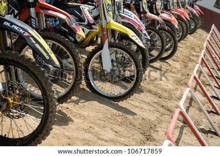 SENKVICE, SLOVAKIA - JULY 1: wheels of motorcycles lined up before start of the race 1 at the Motocross World Championship MX3 on July 1, 2012 in Senkvice, Slovakia - stock photo