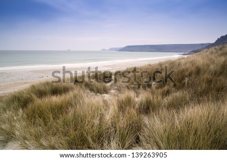 Sennen Cove beach and sand dunes before sunset Cornwall England - stock photo