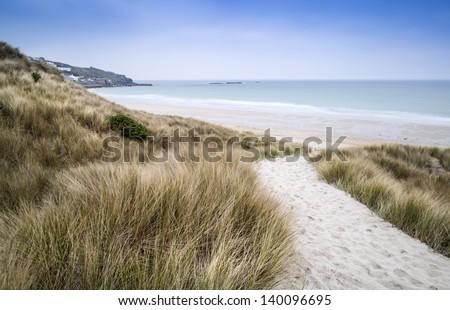 Sennen Cove beach and sand dunes before sunset Cornwall England - stock photo