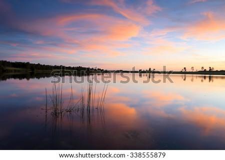Sensational sunset over Duralia Lake, Penrith Lakes, Australia - stock photo