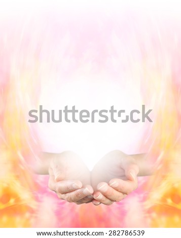 Sensing Golden Healing Energy - Female cupped hands on a golden energy formation background graduating to white at the top providing plenty of copy space - stock photo