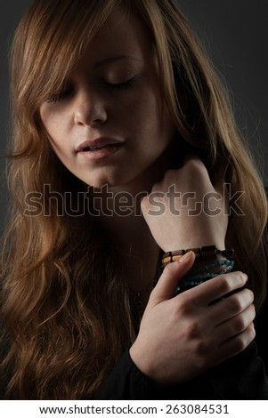 Sensitive red-haired beautiful girl - stock photo