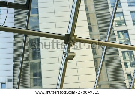 Sensors of the fire alarm system on a glass ceiling of the modern mass production building - stock photo