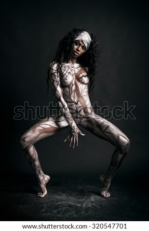Sensual african model body painted with polygons - stock photo