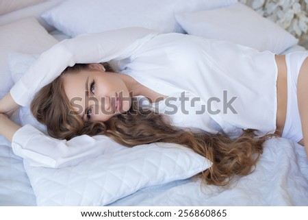 Sensual and beautiful woman in lingerie in the bed - stock photo