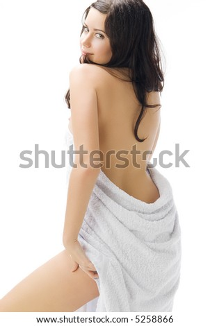 sensual and cute young brunette wearing a white towel playing with the camera and making sexy pose - stock photo