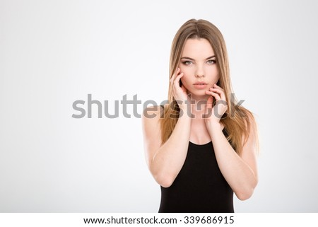 Sensual attractive pretty natural young female touching her face  - stock photo