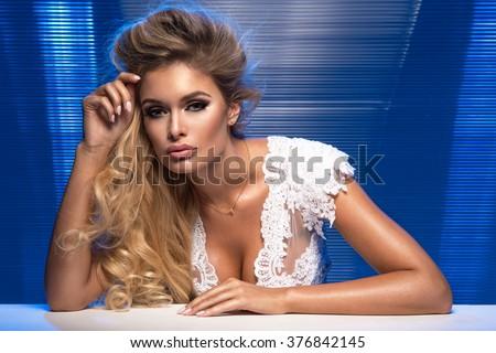 Sensual beautiful blonde woman posing. Girl with long curly hair.  - stock photo