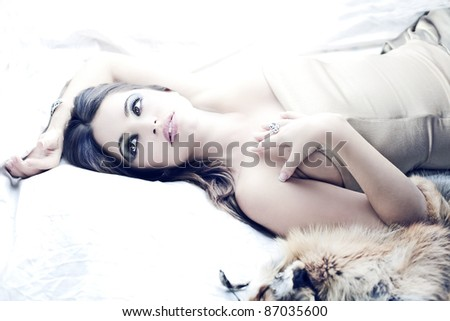 sensual beautiful brunette girl in bed - stock photo