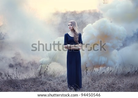 sensual beautiful girl in smoke on nature on sunset - stock photo