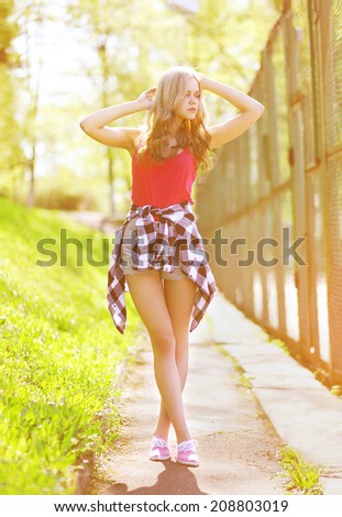 Sensual beautiful hipster girl in urban style posing summer