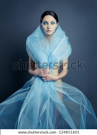 Sensual beautiful nude lady with blue dress-veil - stock photo