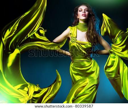 sensual beautiful woman in green fabric - stock photo