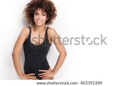 Sensual beautiful woman with afro posing in studio. Glamour makeup. - stock photo