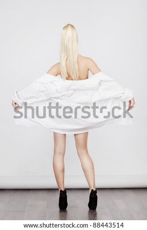 sensual blond in man's shirt - stock photo