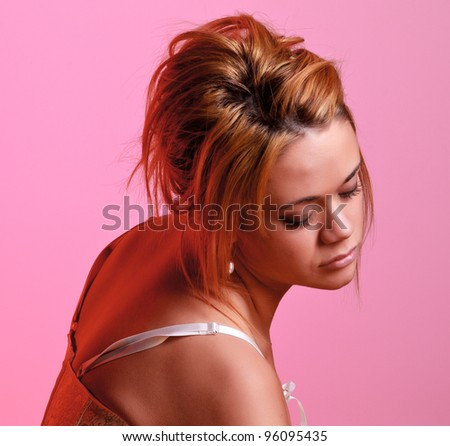 Sensual blonde girl on pink background