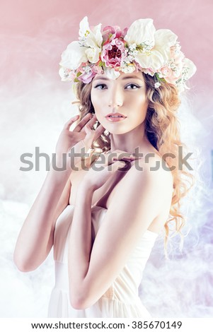 Sensual blonde girl with flowers in her hair. Fashion model. Spring look.  - stock photo