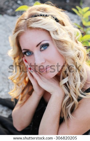 Sensual blonde woman close-up portrait - stock photo