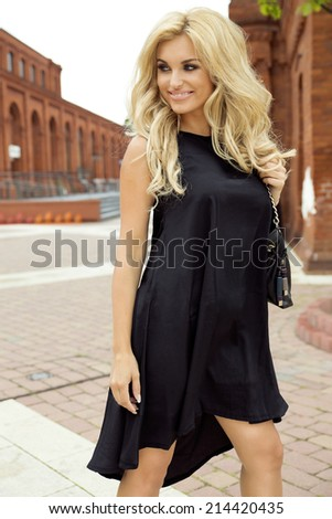 Sensual blonde woman posing outdoor. Sunny summer day