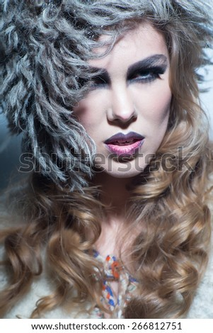 sensual blonde woman with shiny curly silky hair and a headpiece - stock photo