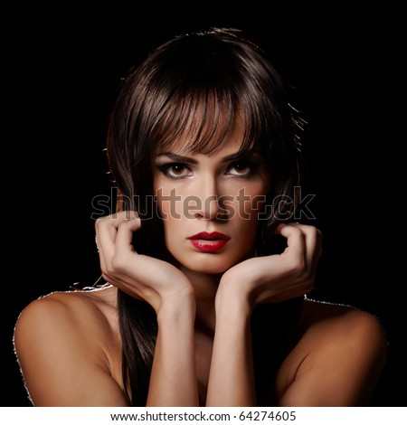 Sensual brunette lady portrait on black background - stock photo
