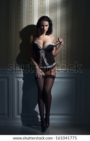Sensual brunette woman at night, vintage background - stock photo
