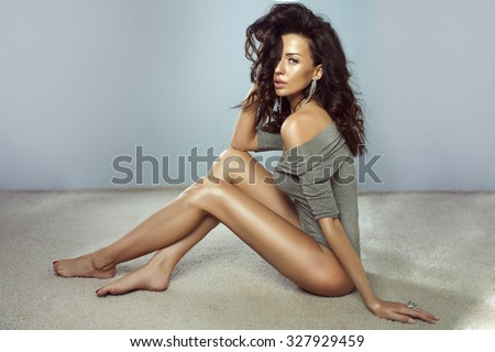 Sensual brunette woman posing, wearing silver jewelry. girl looking at camera. Perfect body. - stock photo
