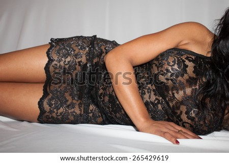 Sensual brunette woman with long hair - stock photo