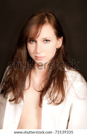 Sensual closeup portrait of sexy young girl in front of black background - stock photo