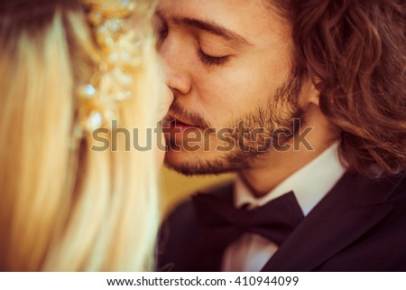 Sensual couple, bride & groom kissing, face closeup