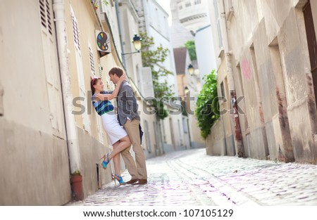 Sensual couple on a street of Montmartre in Paris - stock photo