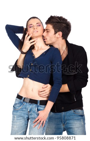 Sensual couple.Young woman enjoying neck kiss.Isolated on white background. High resolution studio image - stock photo